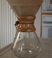 ' ' from the web at 'http://www.howtobrewcoffee.com/images/chemex/chemex_empty_w_filter.jpg'